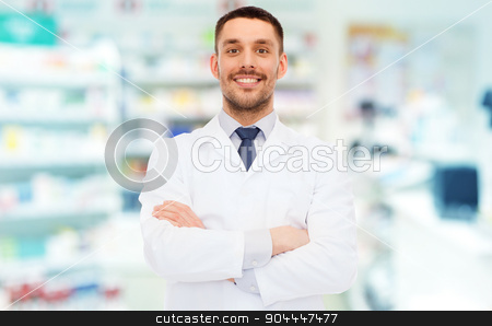 smiling male pharmacist in white coat at drugstore stock photo, medicine, pharmacy, people, health care and pharmacology concept - smiling male pharmacist in white coat over drugstore background by Syda Productions