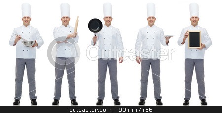 happy male chef cook holding blank menu board stock photo, cooking, profession, advertisement and people concept - happy male chef cook showing and holding blank menu and kitchen utensils board by Syda Productions