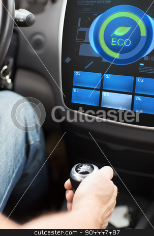 hand with gearshift and car eco mode on screen stock photo, transport, modern, green energy, technology and people concept - male hand on gearshift and car eco system mode on screen by Syda Productions