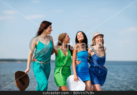 girls walking on the beach stock photo, summer holidays and vacation - girls walking on the beach by Syda Productions