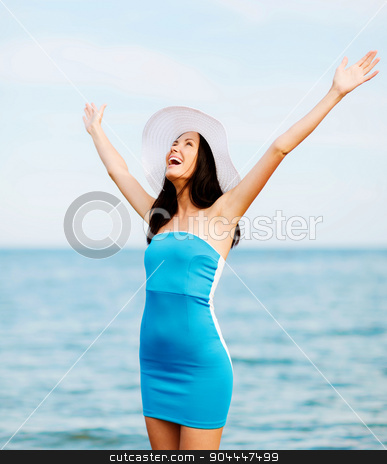 girl with hands up on the beach stock photo, summer holidays and vacation - girl with hands up on the beach by Syda Productions