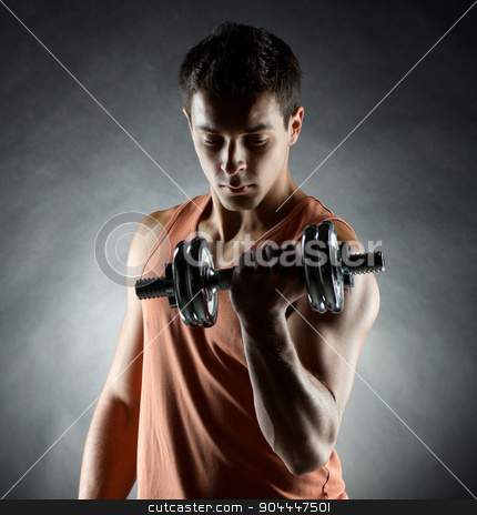 young man with dumbbell stock photo, sport, bodybuilding, training and people concept - young man with dumbbell flexing muscles over gray background by Syda Productions