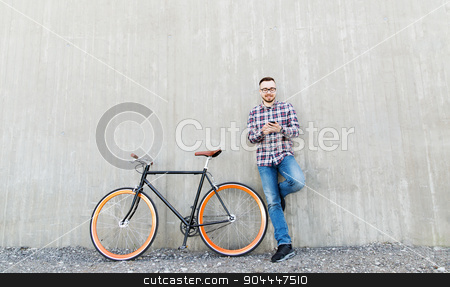 hipster man in earphones with smartphone and bike stock photo, people, style, technology, leisure and lifestyle - happy young hipster man in earphones with smartphone and fixed gear bike listening to music on city street by Syda Productions