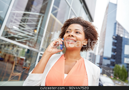 happy african businesswoman calling on smartphone stock photo, business, communication, technology and people concept - young smiling african american businesswoman calling on smartphone in city by Syda Productions