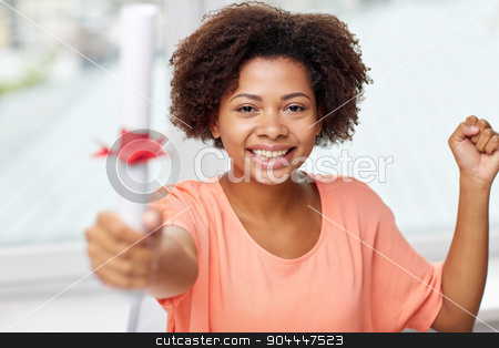 happy african american woman with diploma at home stock photo, people, graduation and education concept - happy african american woman with diploma at home by Syda Productions