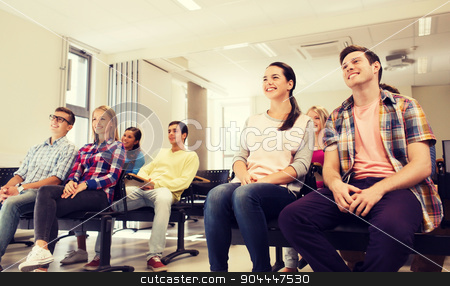 group of smiling students in lecture hall stock photo, education, high school, teamwork and people concept - group of smiling students sitting in lecture hall by Syda Productions