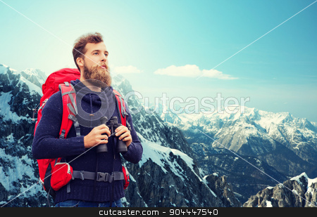 man with backpack and binocular outdoors stock photo, adventure, travel, tourism, hike and people concept - man with red backpack and binocular over alpine mountains background by Syda Productions