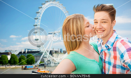 happy couple taking selfie over london stock photo, travel, vacation, technology and friendship concept - happy couple taking selfie over london ferry wheel background by Syda Productions