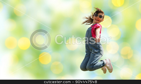 happy little girl jumping high over green lights stock photo, summer, childhood, leisure and people concept - happy little girl jumping high over green summer lights background by Syda Productions