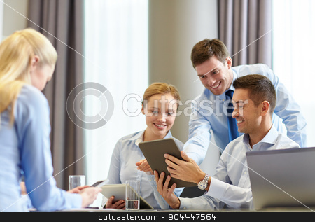 smiling business people with tablet pc in office stock photo, business, people and technology concept - smiling business team with tablet pc computer meeting in office by Syda Productions