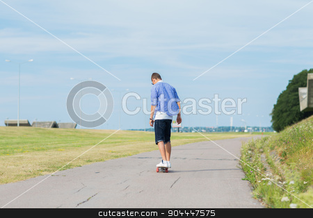 man with longboard or skateboard riding on road stock photo, people, leisure and sport concept - young man riding on longboard or skateboard on road outdoors by Syda Productions