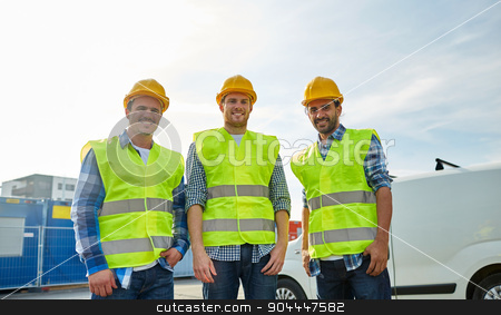 happy male builders in high visible vests outdoors stock photo, industry, building, construction and people concept - happy male builders in high visible vests outdoors by Syda Productions