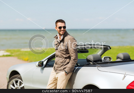 happy man near cabriolet car outdoors stock photo, auto business, transport, leisure and people concept - happy man near cabriolet car outdoors by Syda Productions