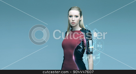 beautiful futuristic woman with virtual projection stock photo, people, future technology and science concept - beautiful futuristic woman with virtual projection over gray background by Syda Productions