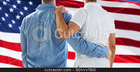 close up of happy male gay couple hugging stock photo, people, homosexuality, same-sex marriage, gay and love concept - close up of happy male gay couple or friends hugging from back over american flag background by Syda Productions