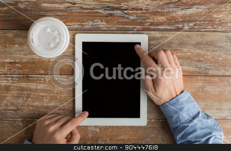 close up of male hands with tablet pc and coffee stock photo, business, education, people and technology concept - close up of male hands with tablet pc computer and coffee paper cup on table by Syda Productions