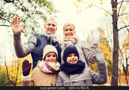 happy family in autumn park stock photo, family, childhood, season, gesture and people concept - happy family waving hands in autumn park by Syda Productions