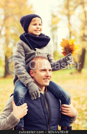 happy family having fun in autumn park stock photo, family, childhood, season and people concept - happy father and son having fun in autumn park by Syda Productions