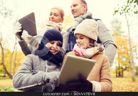 happy family with tablet pc in autumn park stock photo, family, childhood, season, technology and people concept - happy family with tablet pc computers in autumn park by Syda Productions