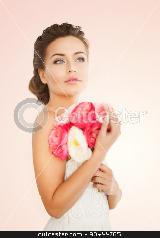 woman with bouquet of flowers stock photo, close up of young woman with bouquet of flowers. by Syda Productions