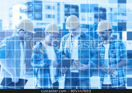 group of smiling builders with tablet pc outdoors stock photo, business, building, teamwork, technology and people concept - group of smiling builders in hardhats with tablet pc computer and clipboard outdoors over blue squared grid background by Syda Productions