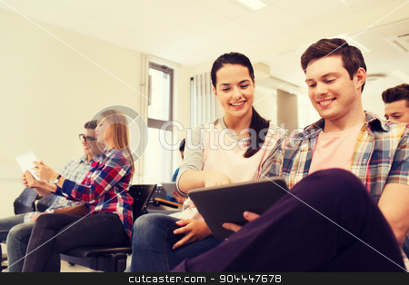 group of smiling students with tablet pc stock photo, education, high school, teamwork and people concept - group of smiling students with tablet pc computers sitting in lecture hall by Syda Productions