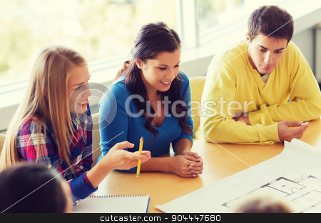 group of smiling students with blueprint stock photo, education, school, architecture and people concept - group of smiling students with blueprint meeting indoors by Syda Productions