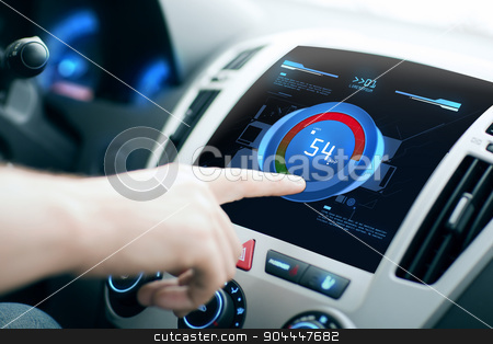 hand setting volume on car audio stereo system stock photo, transport, modern technology and people concept - male hand setting sound volume level on car audio stereo system by Syda Productions