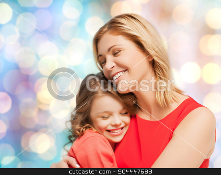 happy mother and daughter hugging stock photo, people, motherhood, family and adoption concept - happy mother and daughter hugging over blue holidays lights background by Syda Productions