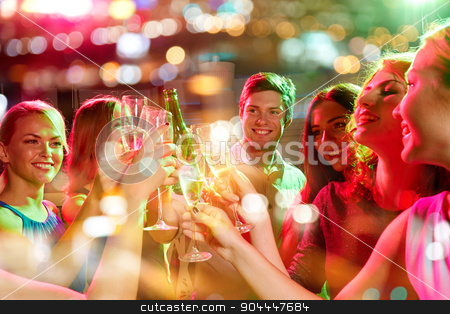 smiling friends with wine glasses and beer in club stock photo, party, holidays, celebration, nightlife and people concept - smiling friends clinking glasses of champagne and beer in club by Syda Productions
