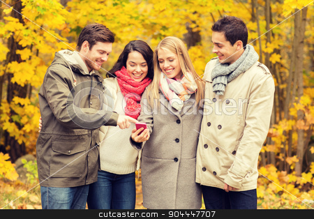 smiling friends with smartphones in city park stock photo, vacation, people, technology and friendship concept - group of smiling friends with smartphone in autumn park by Syda Productions