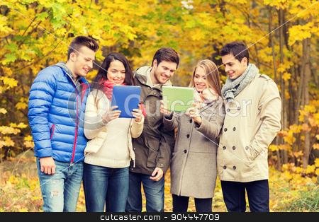 group of smiling friends with tablets in park stock photo, technology, season, friendship and people concept - group of smiling men and women with tablet pc computers in autumn park by Syda Productions