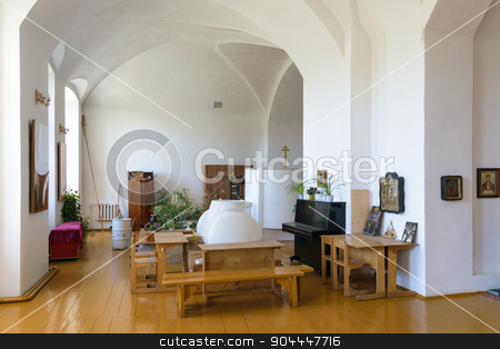 Desks and benches in a room for teaching Sunday school in the Russian church stock photo, The desks and benches in a room for teaching Sunday school in the church. by IgorTravkin