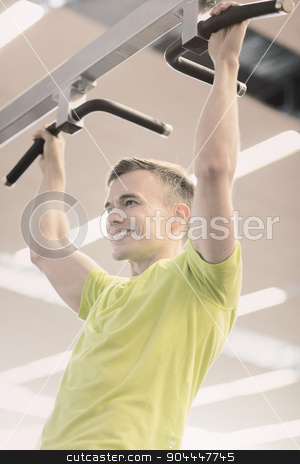 smiling man exercising in gym stock photo, sport, fitness, lifestyle and people concept - smiling man doing pull-ups in gym by Syda Productions