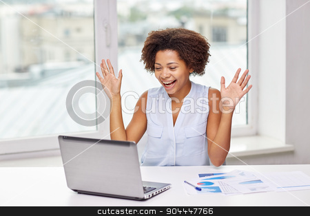 happy african woman with laptop at office stock photo, education, business, success and technology concept - happy african american businesswoman or student with laptop computer and papers at office by Syda Productions