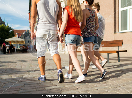 close up of teenage friends walking in city stock photo, friendship, travel, tourism, summer vacation and people concept - close up of teenage friends walking in city from back by Syda Productions