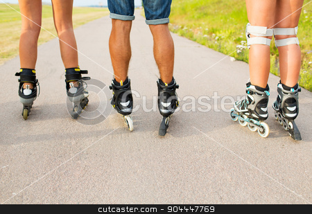 close up of legs in rollerskates skating on road stock photo, leisure, sport and people concept - close up of legs in rollerskates skating on road from back by Syda Productions