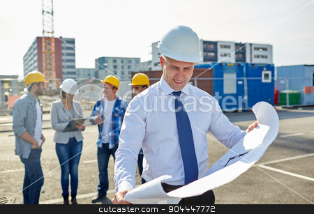 architect with blueprint on construction site stock photo, construction, architecture, business, teamwork and people concept - male architect with blueprint over group of builders on construction site by Syda Productions