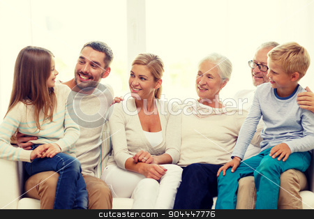 happy family sitting on couch at home stock photo, family, happiness, generation and people concept - happy family sitting on couch at home by Syda Productions