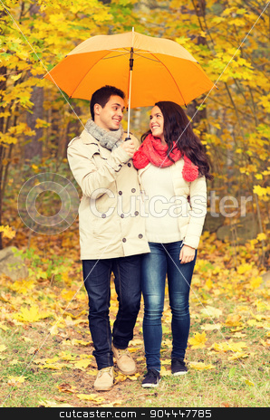 smiling couple with umbrella in autumn park stock photo, love, relationship, season, family and people concept - smiling couple with umbrella walking in autumn park by Syda Productions
