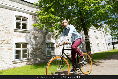 happy young hipster man riding fixed gear bike stock photo, people, style, leisure and lifestyle - happy young hipster man riding fixed gear bike on city street by Syda Productions