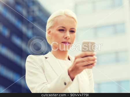 serious businesswoman with smartphone outdoors stock photo, business, technology and people concept - serious businesswoman with smartphone over office building by Syda Productions