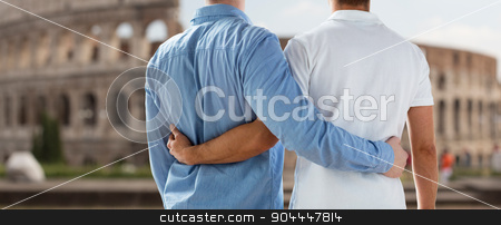 close up of male gay couple over coliseum in rome stock photo, people, homosexuality, same-sex marriage, travel and love concept - close up of happy male gay couple hugging from back over coliseum in rome background by Syda Productions