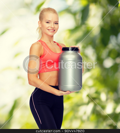 smiling sporty woman with jar of protein stock photo, fitness and diet concept - smiling sporty woman with jar of protein by Syda Productions