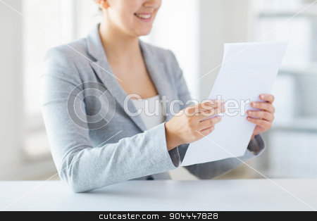 close up of woman reading papers or tax report stock photo, business, finance and people concept - close up of woman reading papers or tax report at office by Syda Productions