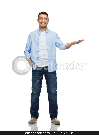 smiling man showing something on empty palm stock photo, happiness, gesture and people concept - smiling man showing something imaginary on empty palm by Syda Productions