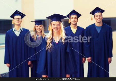 group of smiling students in mortarboards stock photo, education, graduation and people concept - group of smiling students in mortarboards and gowns outdoors by Syda Productions