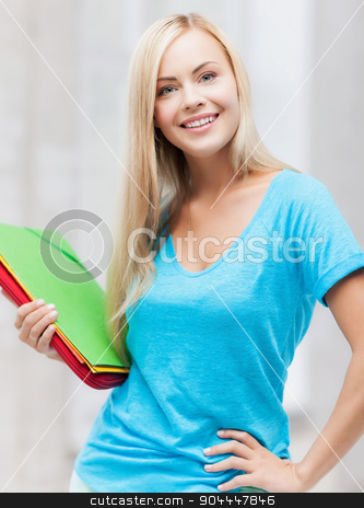 smiling student with folders stock photo, bright picture of smiling student with folders by Syda Productions