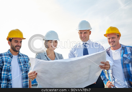 group of builders and architects with blueprint stock photo, business, building, teamwork and people concept - group of builders and architects in hardhats with blueprint on construction site by Syda Productions