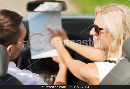 happy man and woman driving in cabriolet car stock photo, road trip, travel, leisure, couple and people concept - happy man and woman driving in cabriolet car with map by Syda Productions